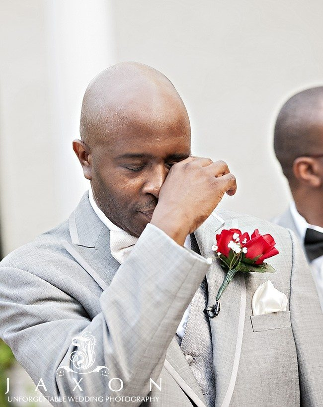 An emotional groom wipes a tear as his bride approaches   Riviera Wedding Brooklyn, NY