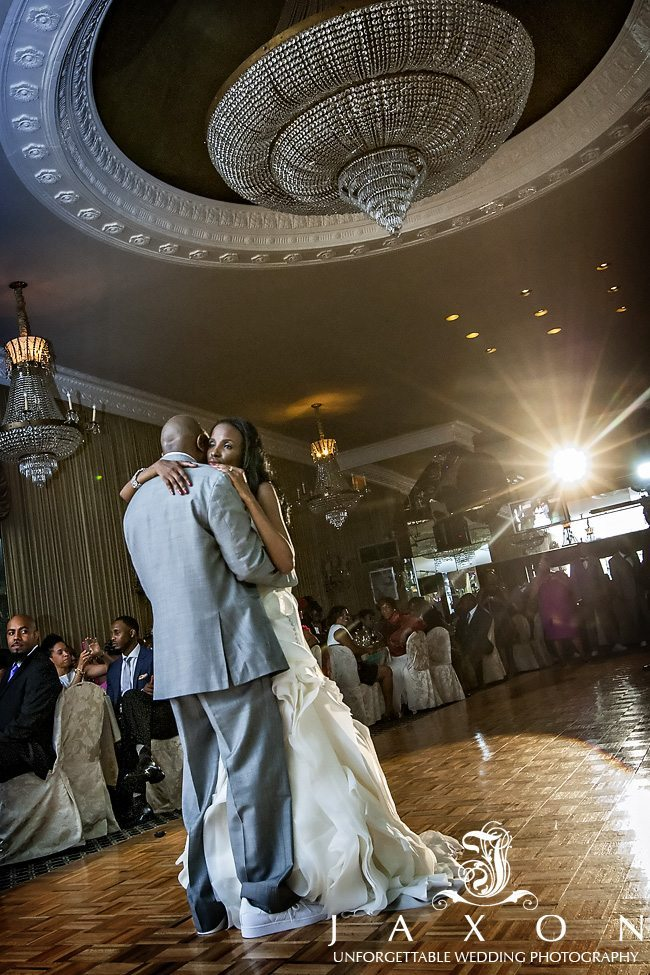 Bride and groom dances for the first time as husband and wife under the impressive chandelier   Riviera Wedding Brooklyn, NY