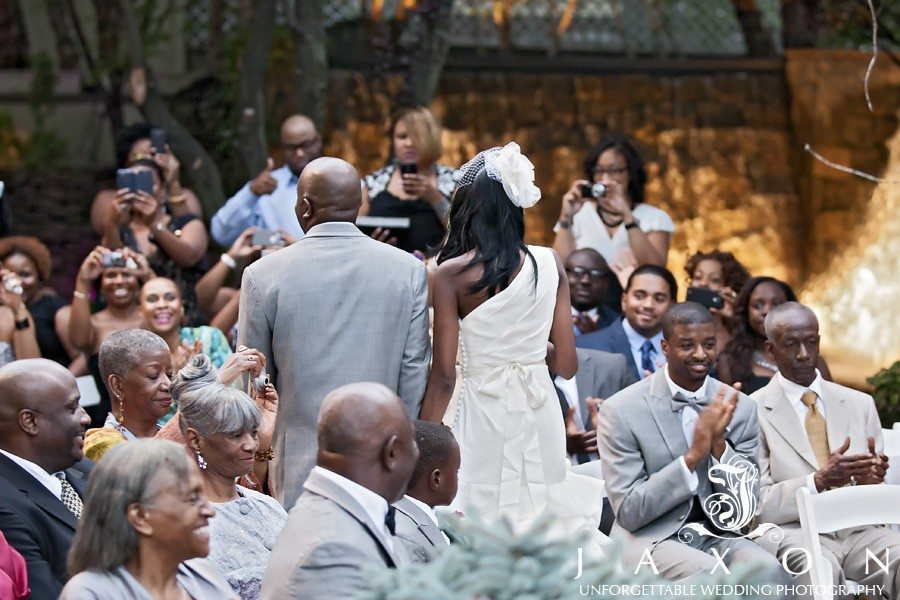 Newly married couple leaves wedding ceremony as their guests applauds   Riviera Wedding Brooklyn, NY