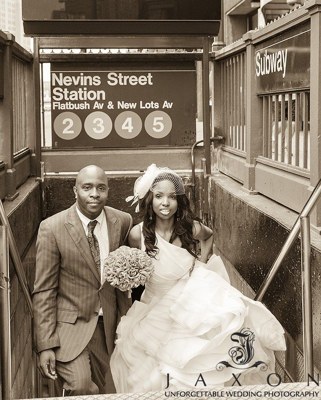 Newly married couple leaves exits the the Nevins Street subway station in Flatbush   Riviera Wedding Brooklyn, NY