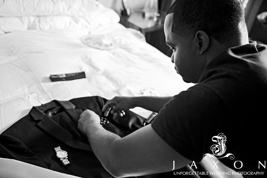Groom preps his suit at the Renaissance Atlanta Midtown Hotel