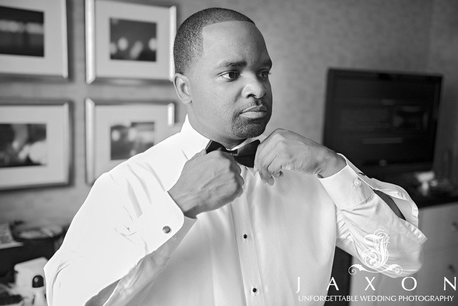 Adjusting his tie at the Renaissance Atlanta Midtown just be fore his Biltmore Ballrooms wedding