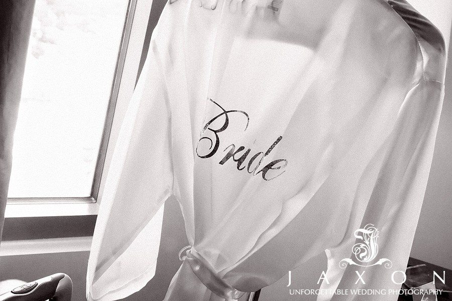 Bride's robe hanging at the Renaissance Atlanta Midtown Hotel before the wedding at her biltmore ballrooms wedding
