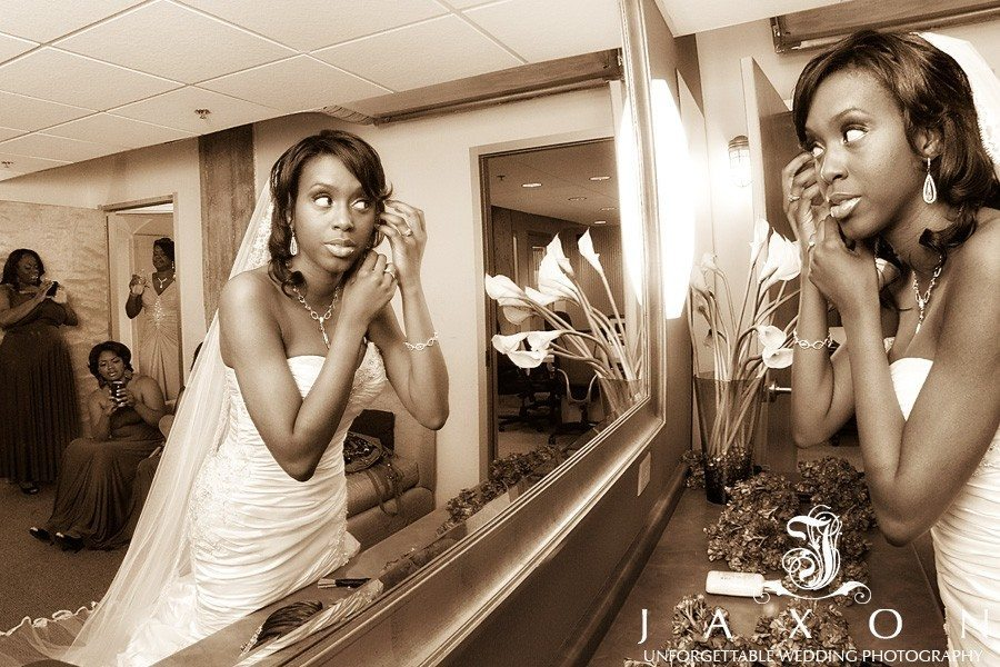 Bride applying finishing touches in the bridal suite downstairs Biltmore Ballrooms Atlanta