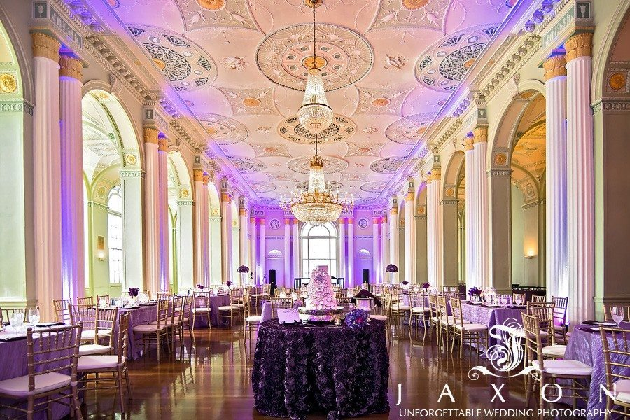 The georgian Ballroom decorated and at the in purple uprights for the wedding reception, the wedding cake in the foreground