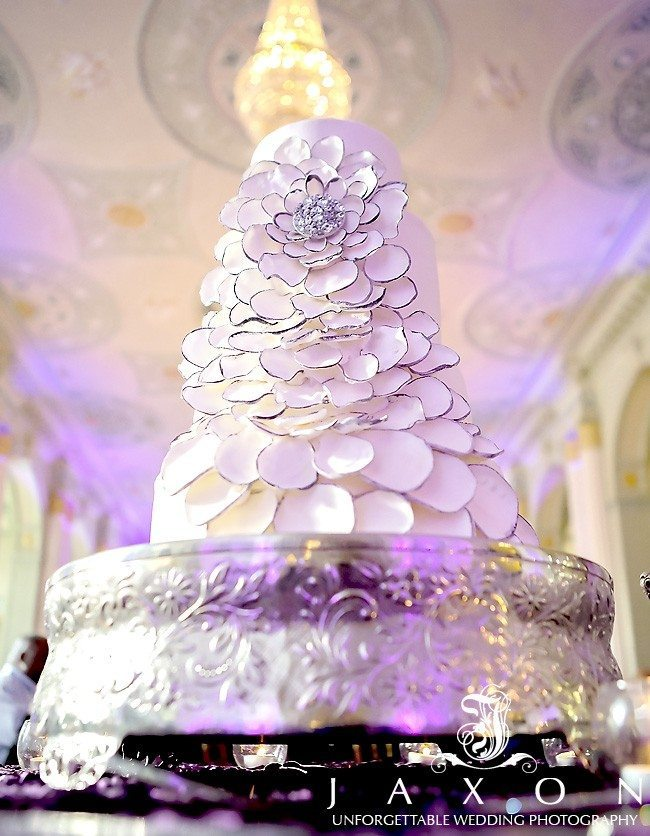 Four tiered wedding cake with large floral designs in the Georgian Ballroom