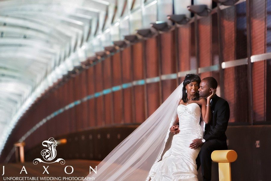 the bride's cathedral veil is extended in this wedding portrait under the decretive overhang on the 17th street bridge at Atlantic station