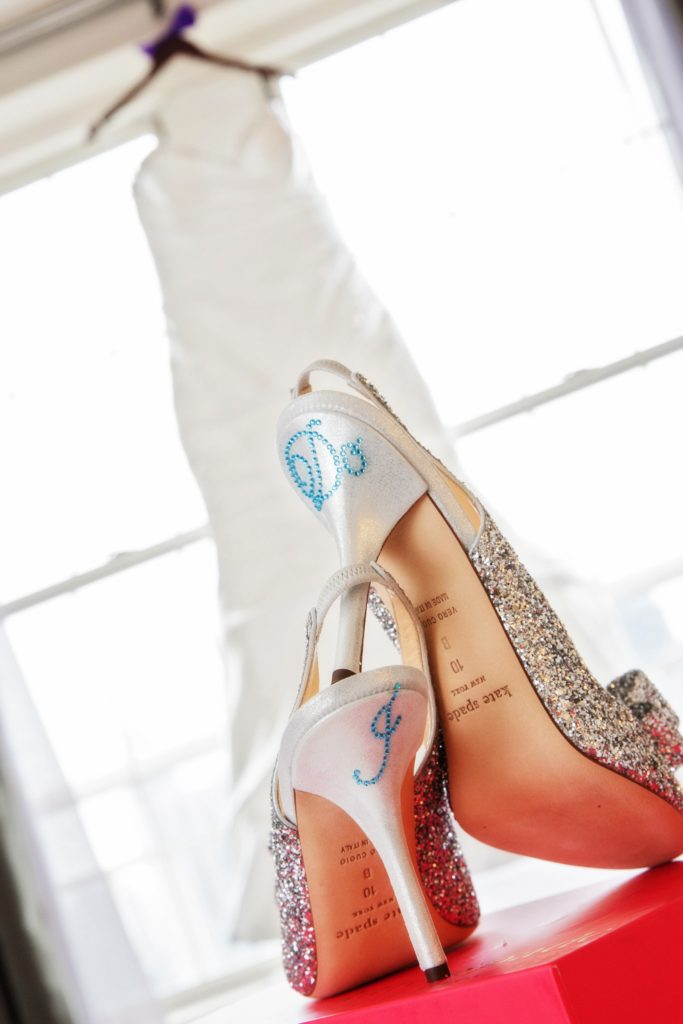Bride Kate Spade wedding pumps with i do written in blue
