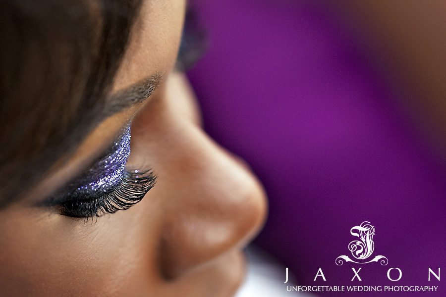 Bride's wedding make up applied in shade of purple and silver in this close-up photograph of her eye