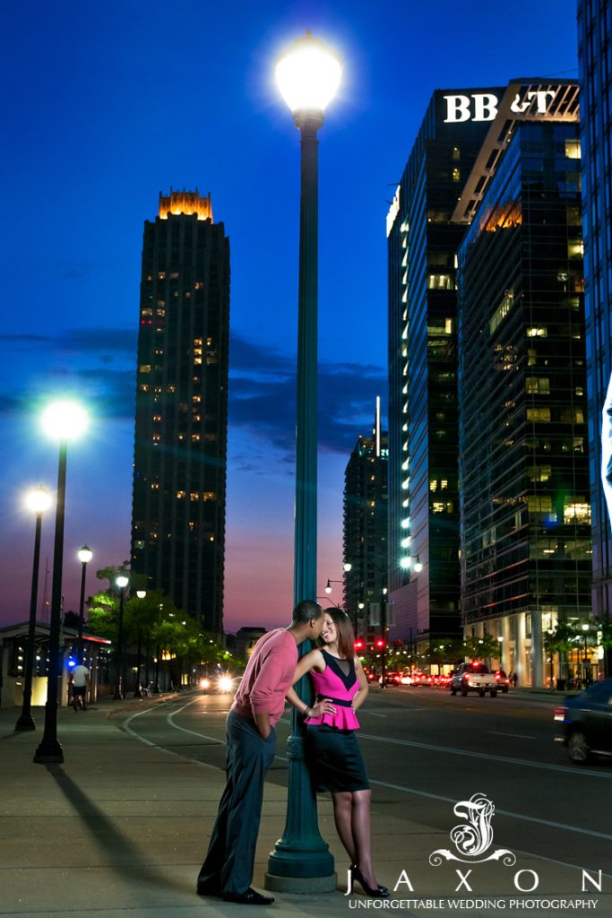 Couple against lamp post at the end of the 17th Street Bridge in Atlantic Station
