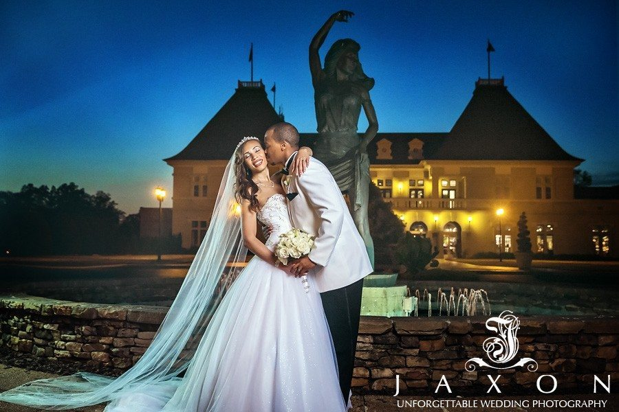 Couple poses in front of the Château Élan winery