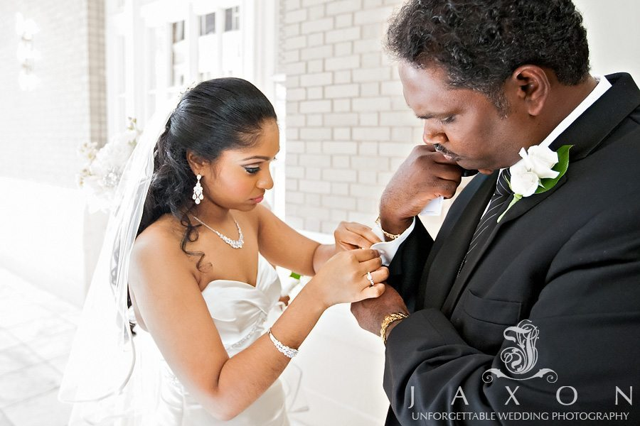 Bride helps her dad with his cuff links