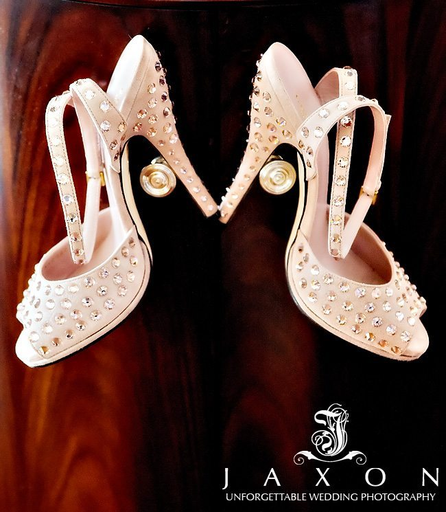 blush Gucci shoes displayed like trophies on the ornate closet handles