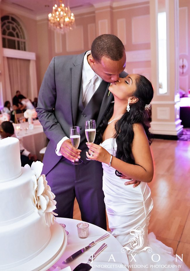 Bride and groom toasts and kiss
