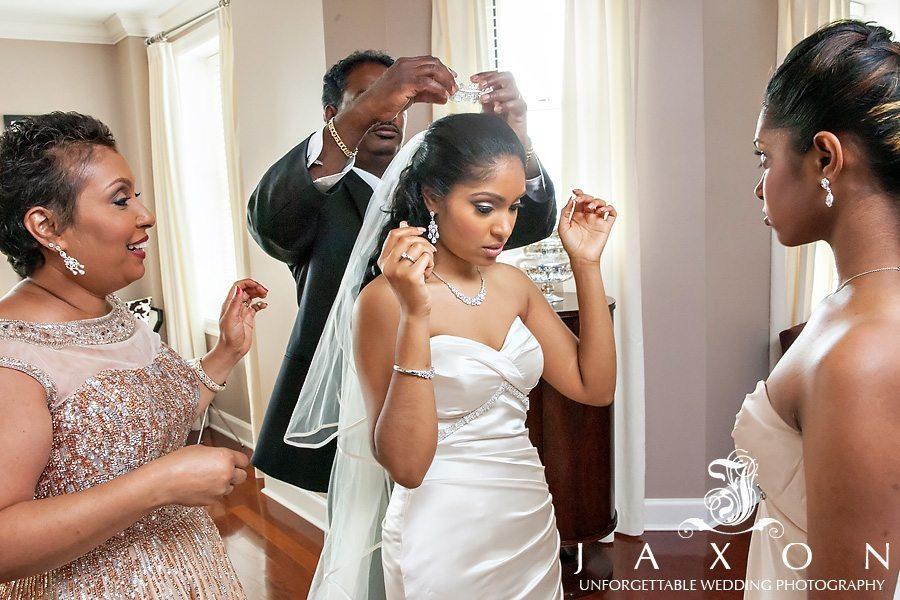 Brides dad attaching her wedding veil