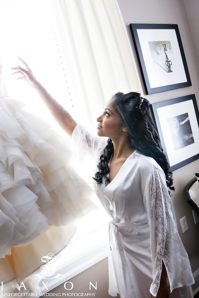Bride reaching for her Winnie Couture gown