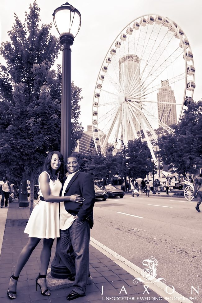 Couple at centennial olympic park with Skyview Ferris Wheel as a backdrop