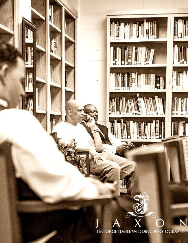 The men sitting in a room with tall wooden bookcases filled with books at Peachtree Christian Church in Atlanta
