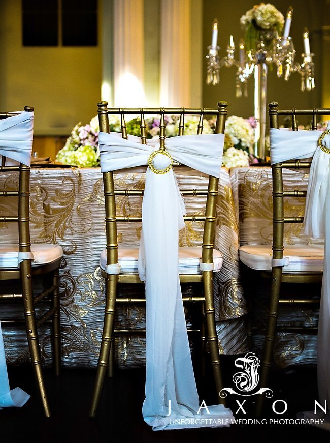 gold Chiavari chairs with fabric tie and gold broach