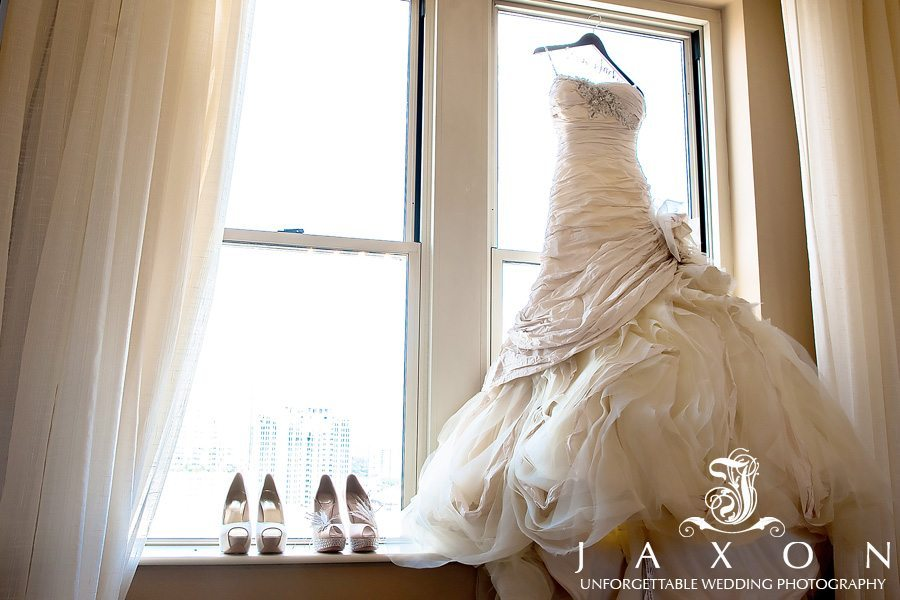 The stunning dramatic mermaid styled bridal gown and two pairs of bridal shoes at the Georgian Terrace