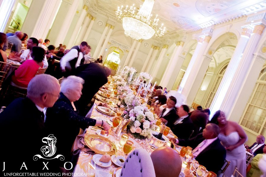 The wedding guests feasting and having a good time during the reception in the Georgian Ballroom at The Biltmore ATlanta