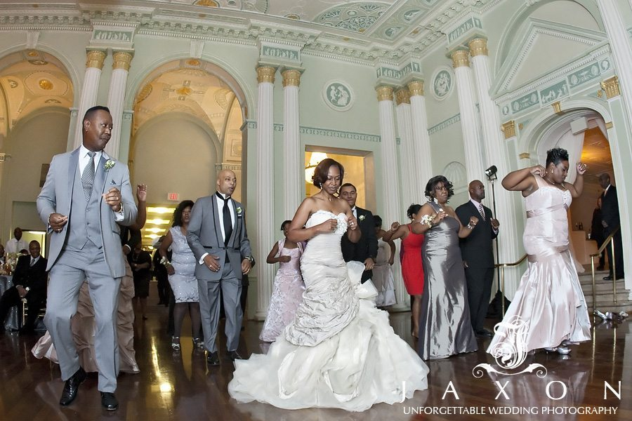 The bride and groom dancing along with some of their wedding guests