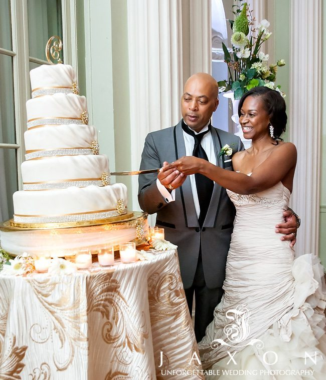Cutting the 5 tiered wedding cake at the Biltmore Ballrooms Atlanta