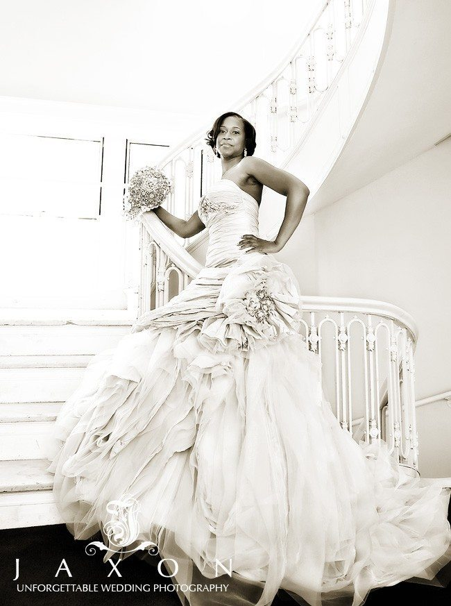 Sepia photo of Bride on Spiral Stair Case at Georgian Terrace Hotel