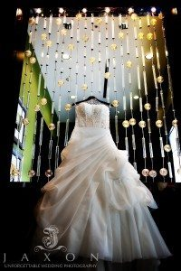 Choosing Your Photographer | Wedding dress hanging in the lobby at Atlanta Airport Gateway Marriott