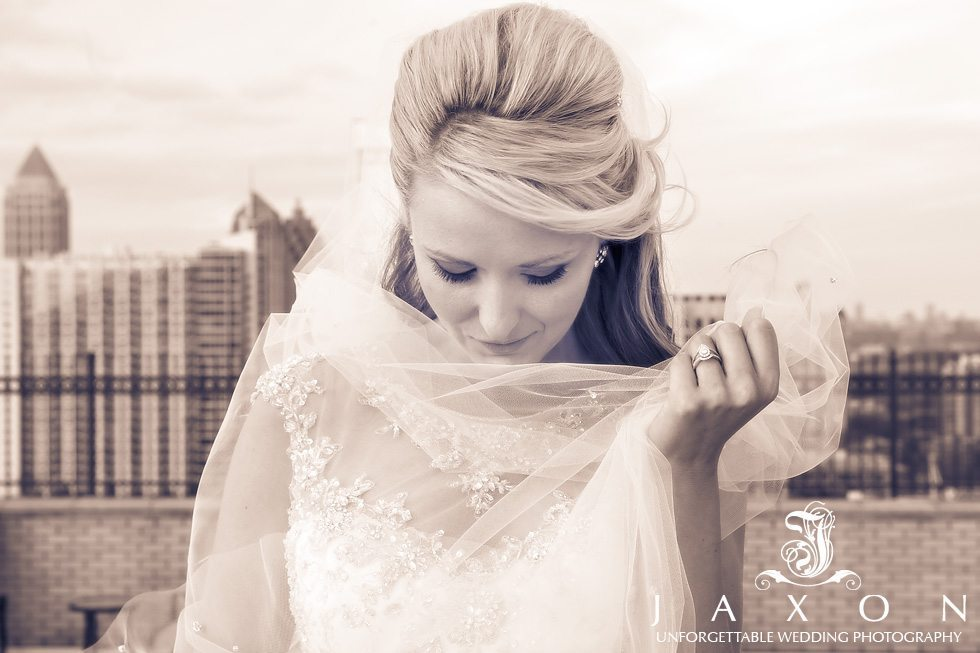 A moody sepia toned portrait of bride on the roof of the Georgian Terrace in Atlanta