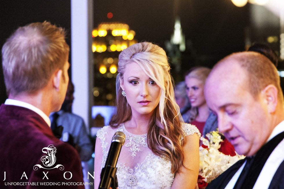 Bride with a look of concern as minister directs wedding vows
