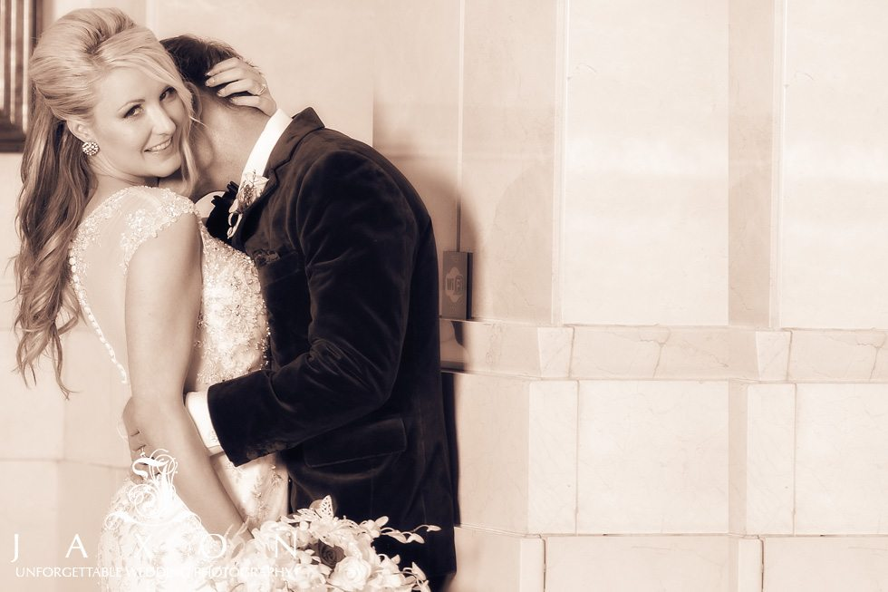 A seductive embrace, the couple steals a moment after their wedding ceremony
