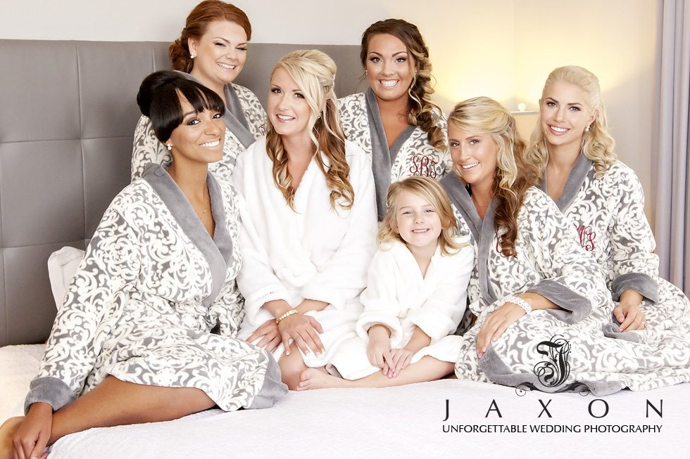 Bride and Party on bed in matching gray and white terry robes at the Georgian Terrace Hotel Atlanta