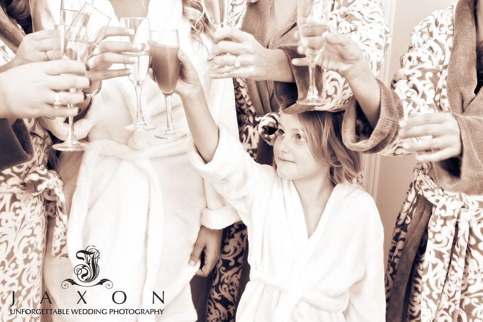 Flower girl toasts with the rest of the bridal party as they prepare for wedding ceremony