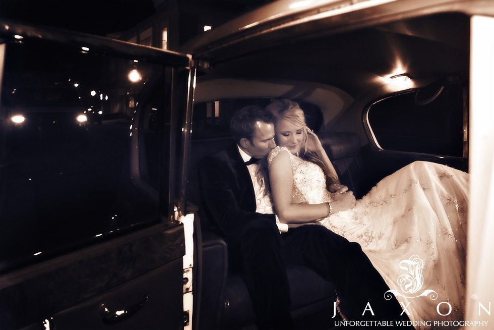 Couple in the backseat of a vintage Rolls at the end off the night | Peachtree Club Rooftop Wedding