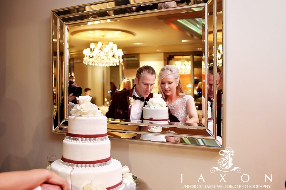 Cutting the cake at Peachtree Club, the photograph of the couples reflection in the mirror.