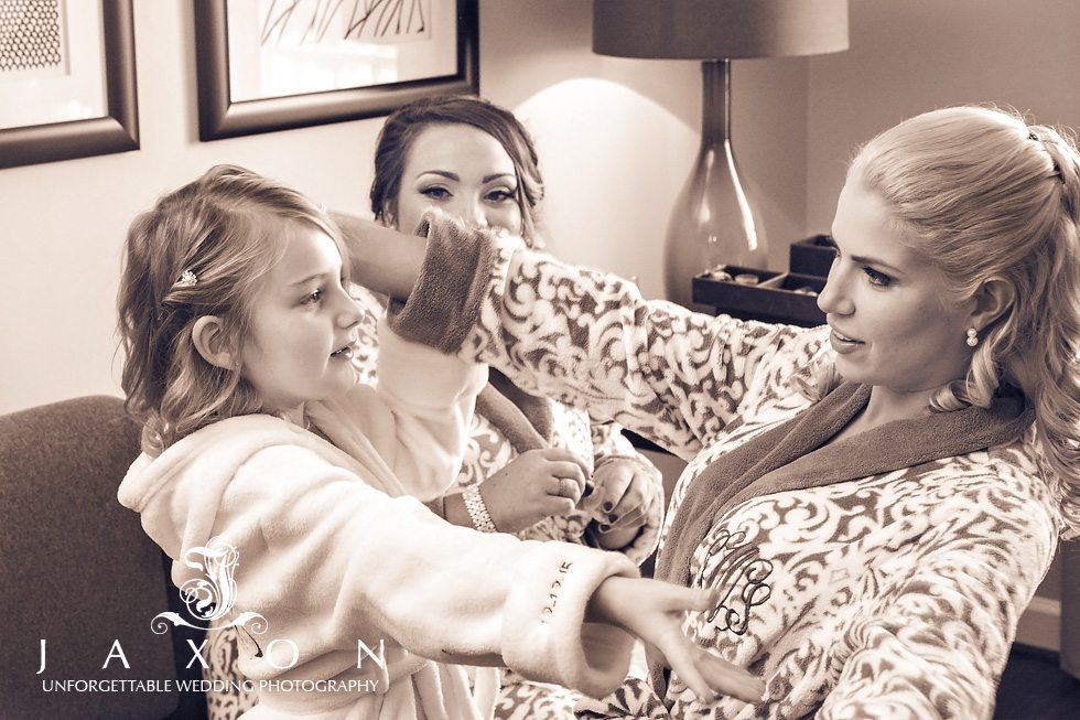 Bridesmaids and flower girl share an embrace in the bridal suite at Georgian Terrace Hotel Atlanta