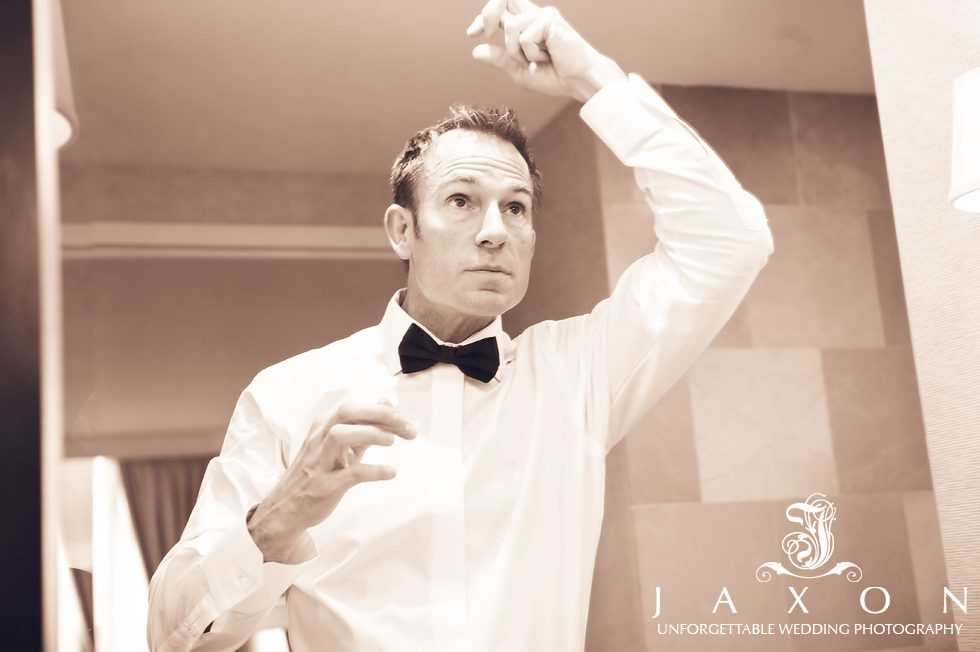 Groom making last minute preparations before he leaves the Ritz for his wedding at The Paechtree Club