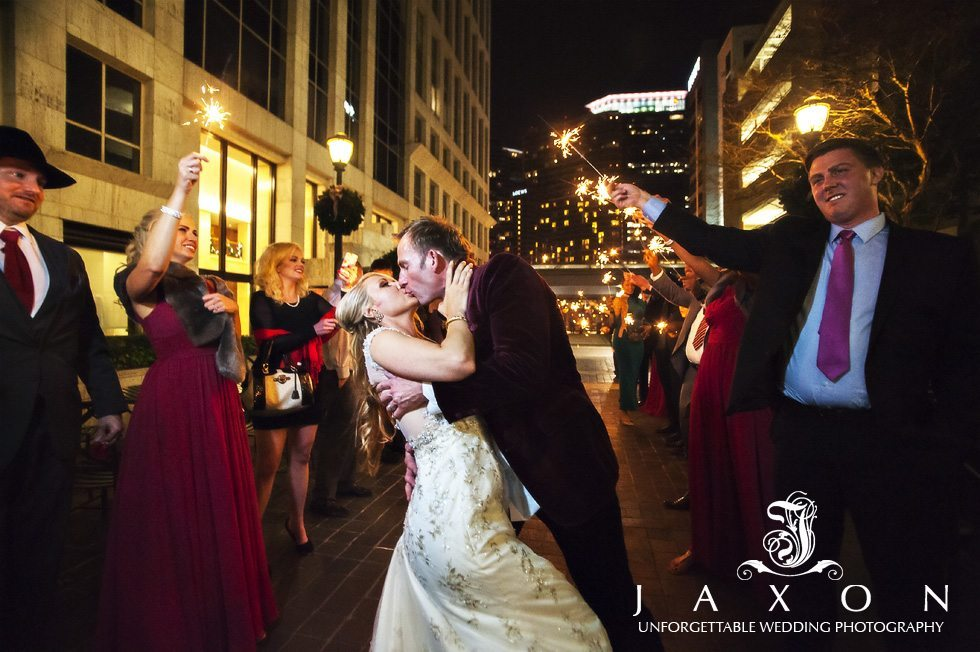Kiss goodnight, couple exits wedding reception amidst sparklers in the courtyard of the Peachtree club