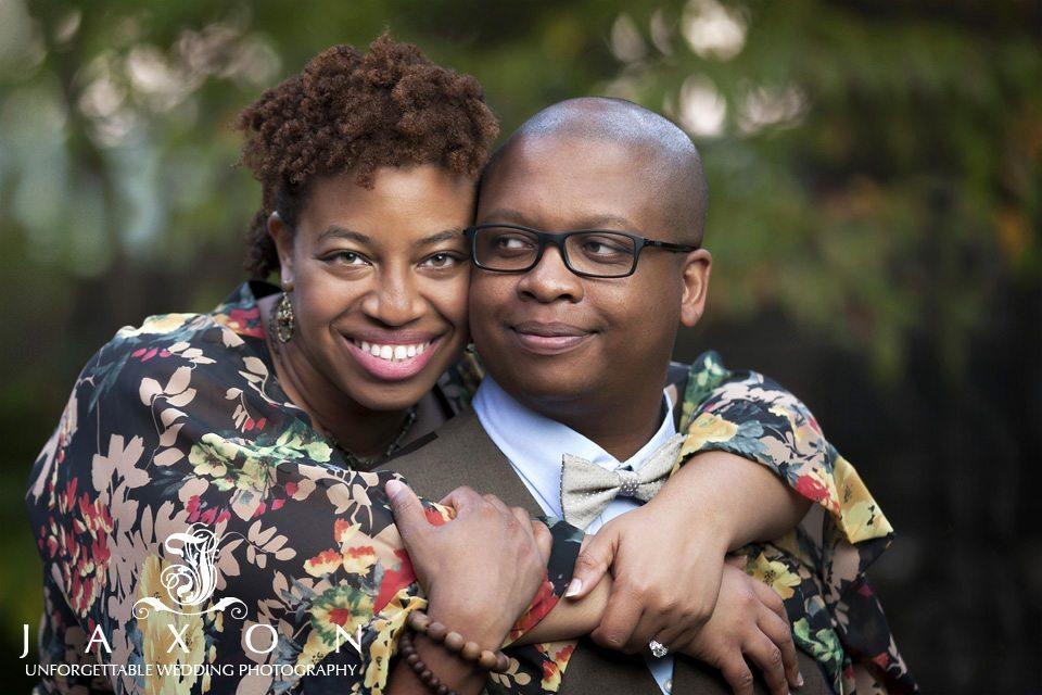 Couple embraces durring stone mountain engagement