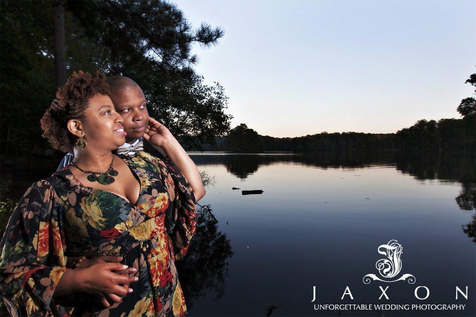 couple next to lake at stone mountain park
