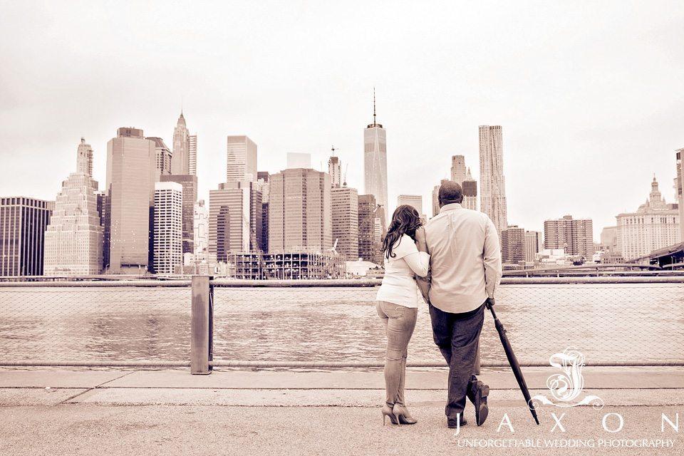 Couple ilooking at New York city from brooklyn Brooklyn bridge park in NY