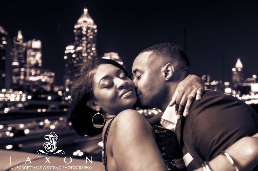 Sepia toned image of couple embrace 17th street bridge gateway to Atlantic Station looking over I75/85 to the midtown Atlanta skyline as a backdrop.
