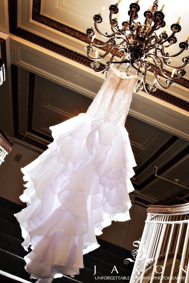 Bride dress hanging from chandelier at the Venetian-Room Atlanta