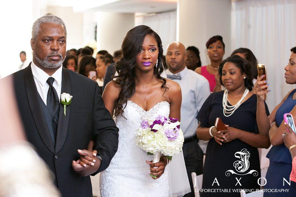 Emotional Bride escorted into wedding ceremony by dad