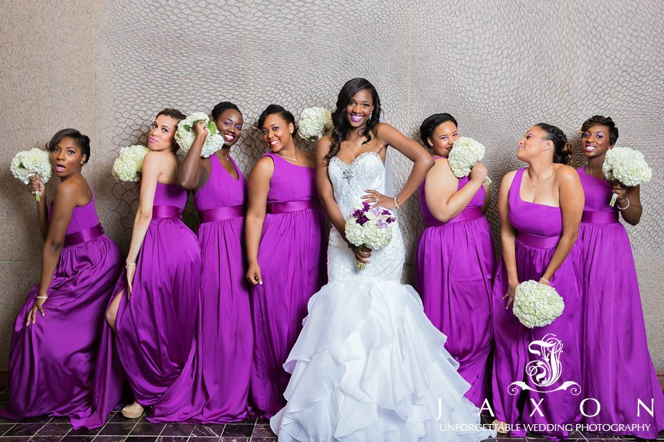 Bride and bridesmaids strike a fun pose for the camera