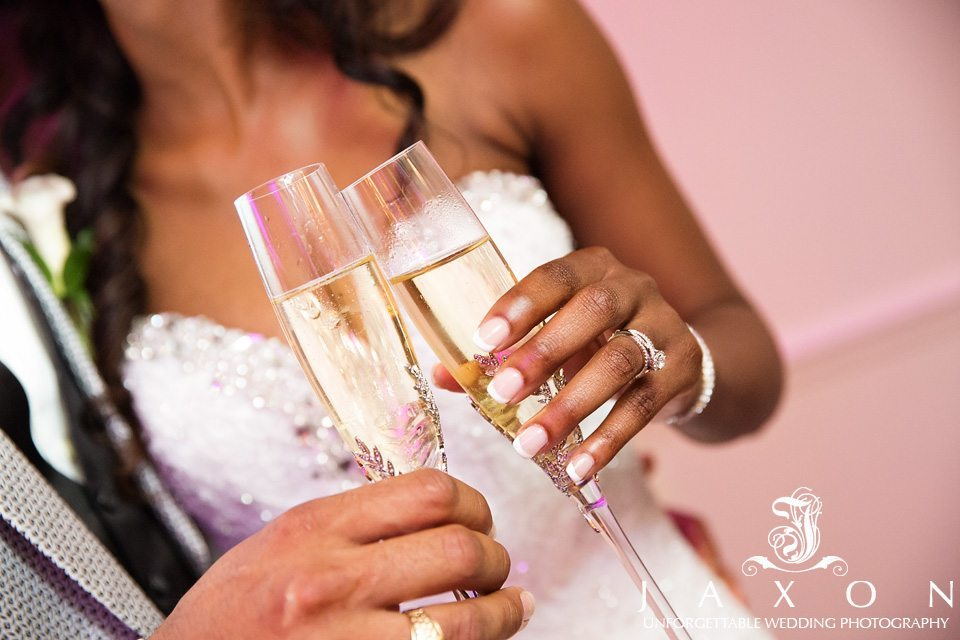 close up photo of wedding couple glasses as they toasts each other