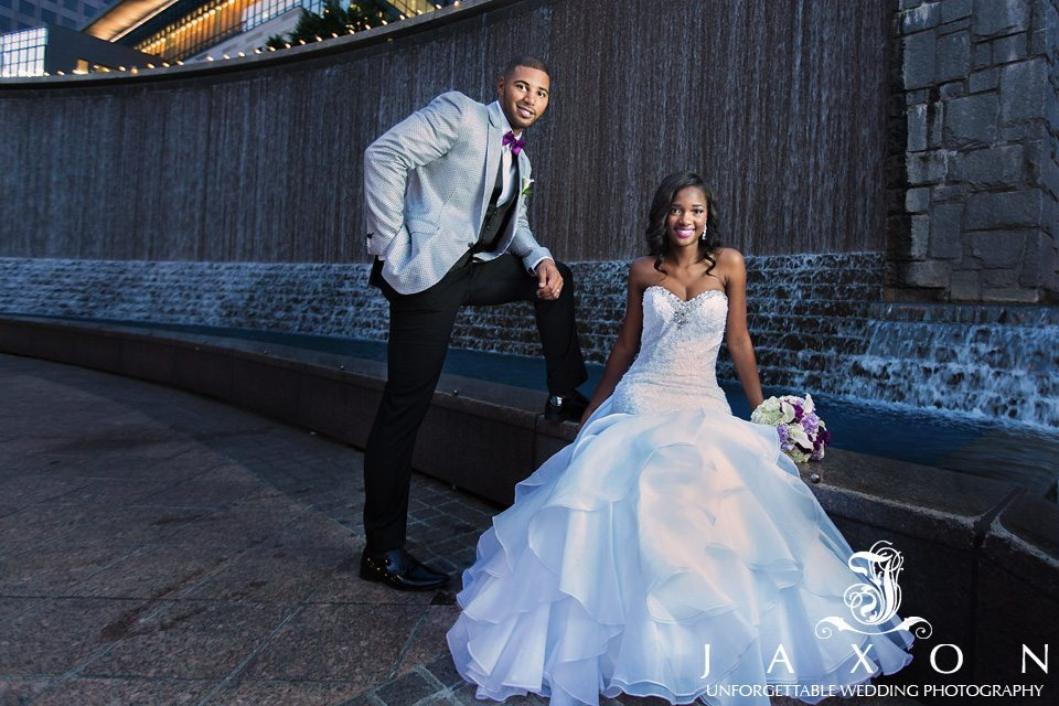 Bride and groom at woodruff park waterfall in downtown atlanta
