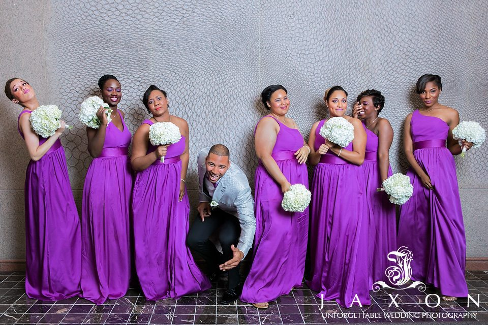 Groom have some fun with bridesmaids at picture time