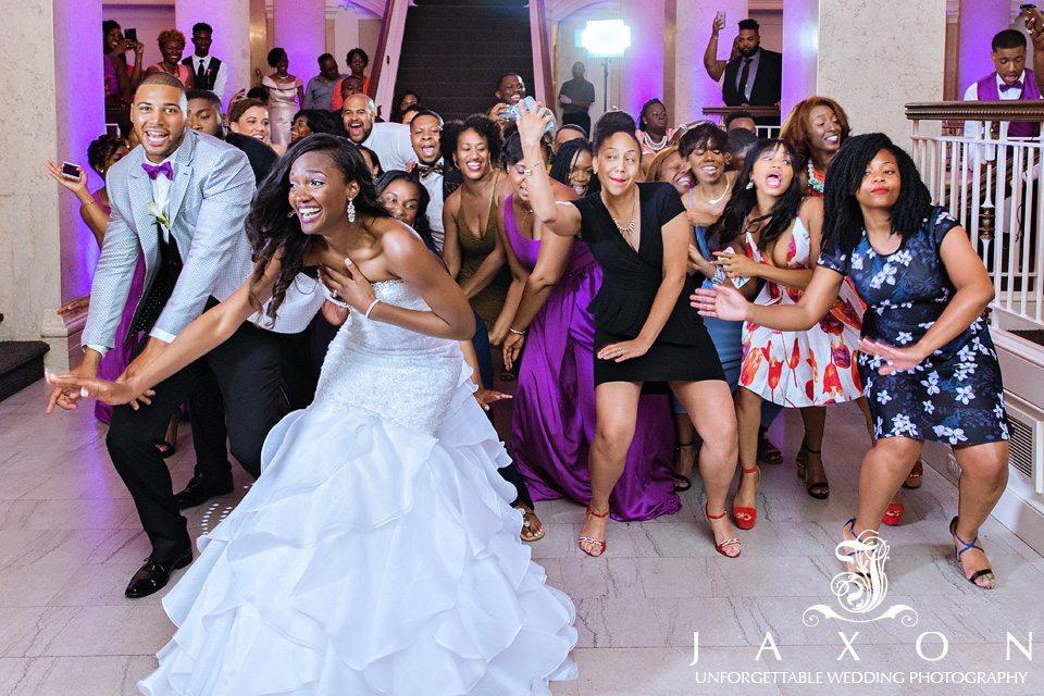 Wedding couple and guests dance during wedding reception, Venetian Room Atlanta Wedding